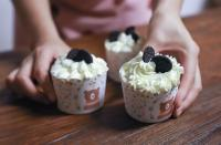 Cookies on white icing cupcakes