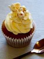 Cupcake topped with popcorn and yellow icing