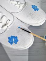 DIY white sneakers with blue illustrations