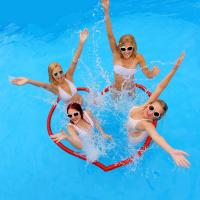Friends in pool and heart float