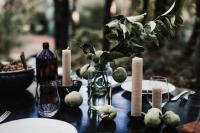 Green and white table setting at dinner party