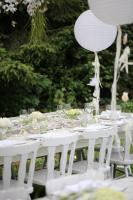 Green and white table setting at spring party