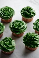 Green cupcakes on white background
