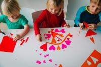 Kids playing with Valentines crafts