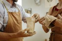 People holding pottery
