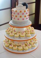 Pink and yellow cupcake stand at bridal shower