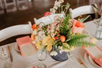 Pink and yellow flower arrangement and decor at wedding