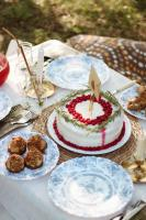 Red and white cake on table