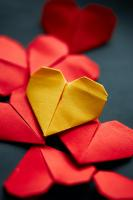 Red and yellow paper hearts