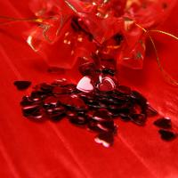 Red heart shaped filled confetti bag