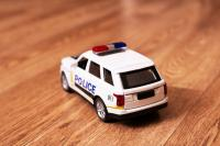 Toy police car on wooden surface
