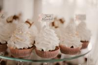 Wedding cupcakes with just married topper